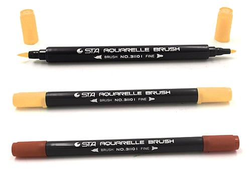 A picture of three artistic markers