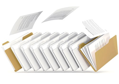 A picture of several partly-open file folders with some documents flying out
